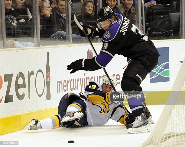 Tim Connolly of the Buffalo Sabres is checked to the ice by Jack Johnson of the Los Angeles Kings during the first period at the Staples Center on...