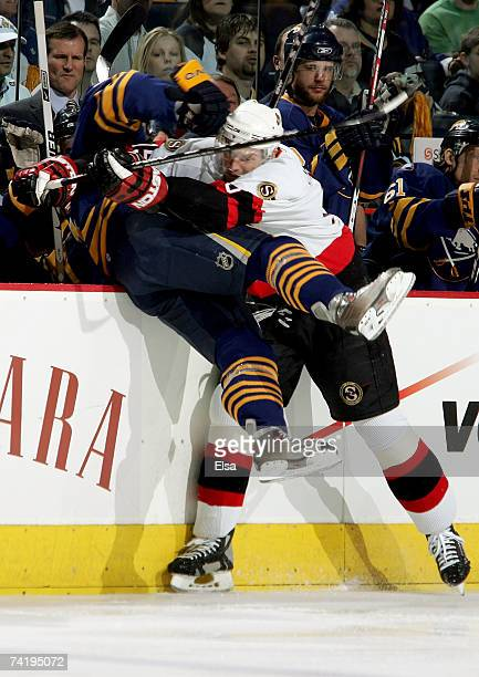 Tim Connolly of the Buffalo Sabres is pushed into the bench by Dany Heatley of the Ottawa Senators during the first period of Game 5 of the 2007...