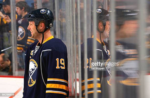 Tim Connolly of the Buffalo Sabres is reflected in the glass while warming up to play against the New York Rangers on January 9 2009 at HSBC Arena in...