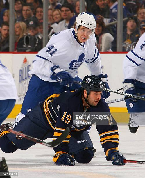 Tim Connolly of the Buffalo Sabres is upended by Nikolai Kulemin of the Toronto Maple Leafs on February 4 2009 at HSBC Arena in Buffalo New York