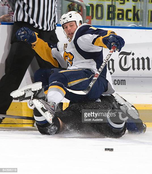 Tim Connolly of the Buffalo Sabres lands of Ryan Malone of the Tampa Bay Lightning after checking him during the first period at the St Pete Times...