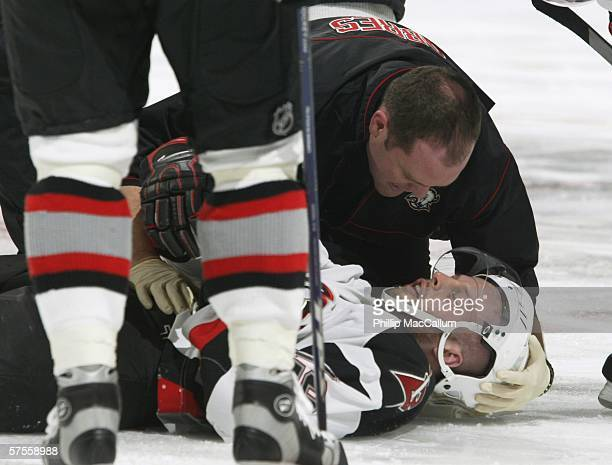 Tim Connolly of the Buffalo Sabres lies on the ice during game two of the Eastern Conference Semifinals of the 2006 NHL Stanley Cup Playoffs against...