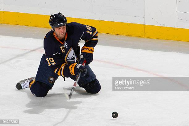 Tim Connolly of the Buffalo Sabres makes a pass from his knees against the New York Rangers at HSBC Arena on December 5 2009 in Buffalo New York