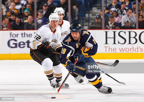 Tim Connolly of the Buffalo Sabres moves the puck trailed by Todd Marchant and Bret Hedican of the Anaheim Ducks on February 24 2009 at HSBC Arena in...