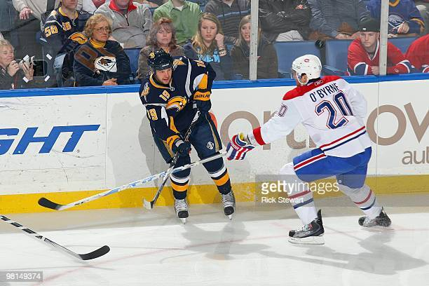 Tim Connolly of the Buffalo Sabres passes the puck against Ryan O'Byrne of the Montreal Canadiens at HSBC Arena on March 24 2010 in Buffalo New York