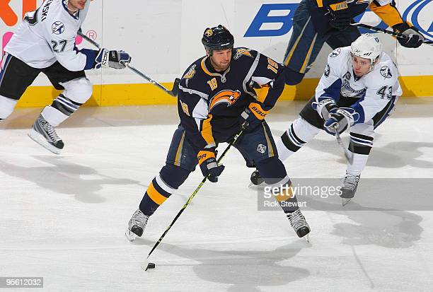 Tim Connolly of the Buffalo Sabres readies to shoot as James Wright of the Tampa Bay Lightning defends at HSBC Arena on January 6 2010 in Buffalo New...