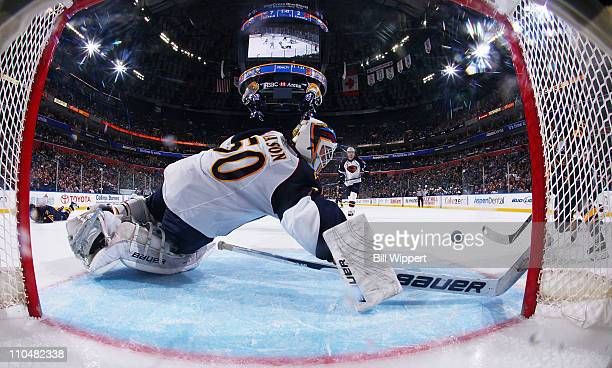 Tim Connolly of the Buffalo Sabres scores a third period goal past Chris Mason of the Atlanta Thrashers at HSBC Arena on March 19 2011 in Buffalo New...
