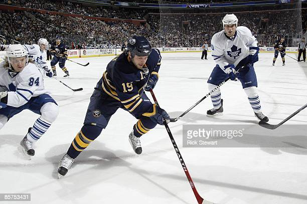 Tim Connolly of the Buffalo Sabres skates against Mikhail Grabovski and Phil Oreskovic of the Toronto Maple Leafs on March 27 2009 at HSBC Arena in...