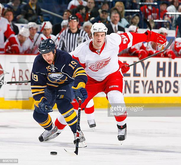 Tim Connolly of the Buffalo Sabres skates ahead of Jonathan Ericsson of the Detroit Red Wings on April 6 2009 at HSBC Arena in Buffalo New York