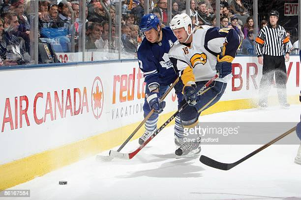 Tim Connolly of the Buffalo Sabres skates for the puck against Pavel Kubina of the Toronto Maple Leafs during their NHL game at the Air Canada Centre...