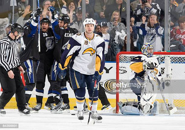 Tim Connolly of the Buffalo Sabres skates off the ice as Vaclav Prospal of the Tampa Bay Lightning celebrates a goal with teammate Vincent Lecavalier...