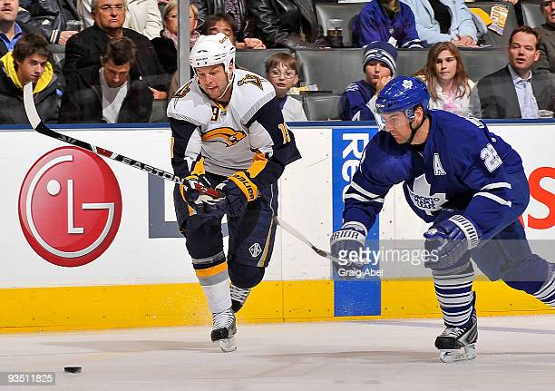 Tim Connolly of the Buffalo Sabres skates the puck away from Francois Beauchemin ov the Toronto Maple Leafs during game action November 30 2009 at...