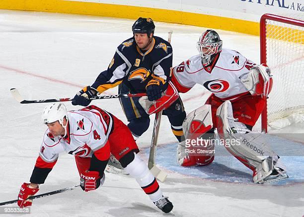 Tim Connolly of the Buffalo Sabres skates through the crease area as goaltender Michael Leighton of the Carolina Hurricanes faces the shooter during...