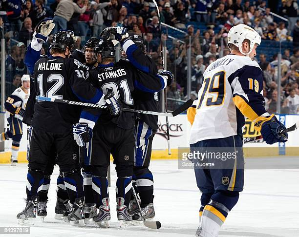 Tim Connolly of the Buffalo Sabres skates to the bench as Tampa Bay Lightning players celebrate a goal during the first period at the St Pete Times...