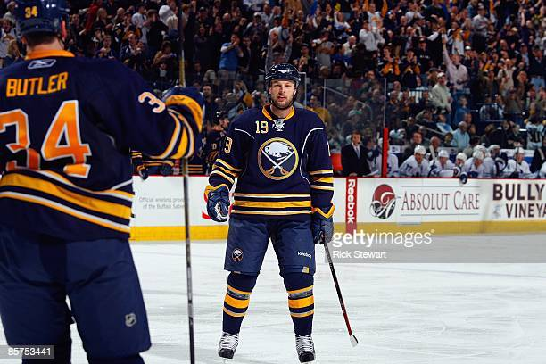 Tim Connolly of the Buffalo Sabres skates toward teammate Chris Butler after he scored a goal against the Toronto Maple Leafs on March 27 2009 at...