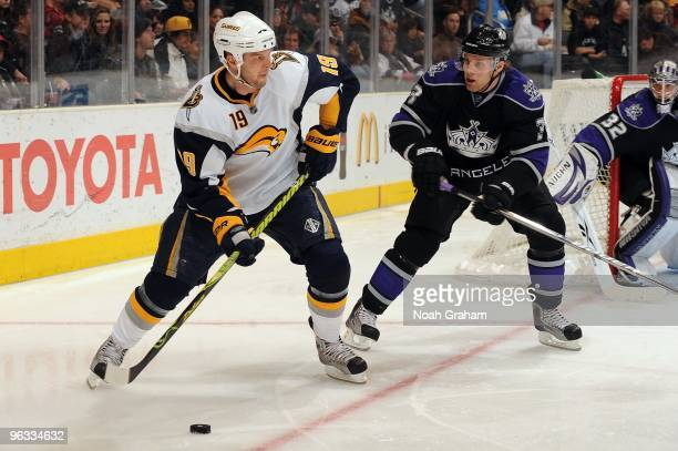 Tim Connolly of the Buffalo Sabres skates with the puck against Jack Johnson of the Los Angeles Kings on January 21 2010 at Staples Center in Los...