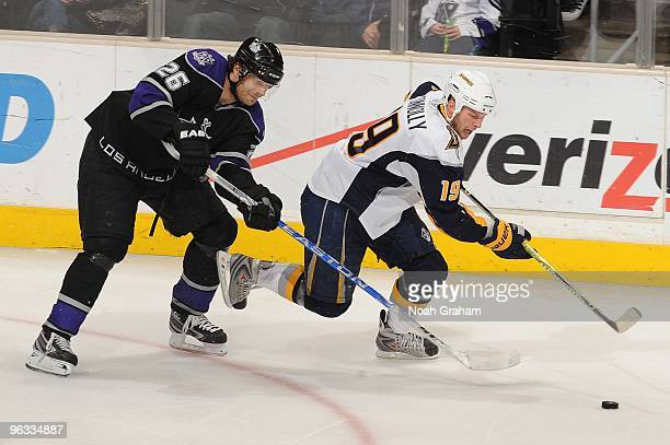 Tim Connolly of the Buffalo Sabres skates with the puck against Michal Handzus of the Los Angeles Kings on January 21 2010 at Staples Center in Los...