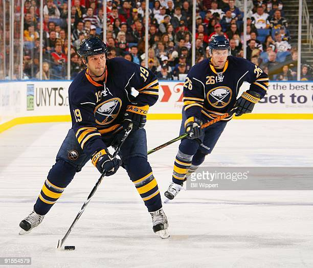 Tim Connolly of the Buffalo Sabres skates with the puck against the Montreal Canadiens trailed by teammate Thomas Vanek on October 3 2009 at HSBC...