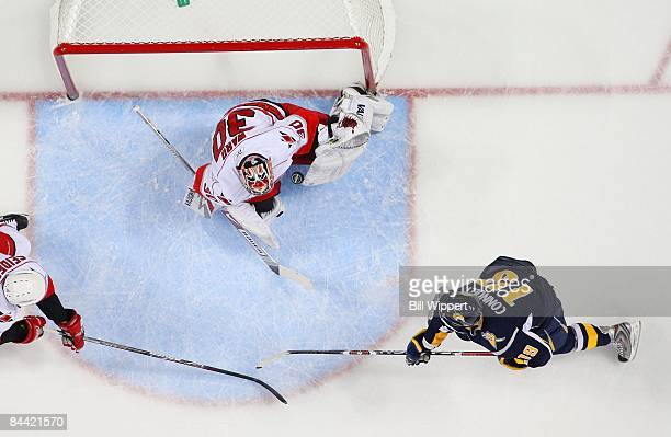 Tim Connolly of the Buffalo Sabres takes a shot at Cam Ward of the Carolina Hurricanes on January 17 2009 at HSBC Arena in Buffalo New York