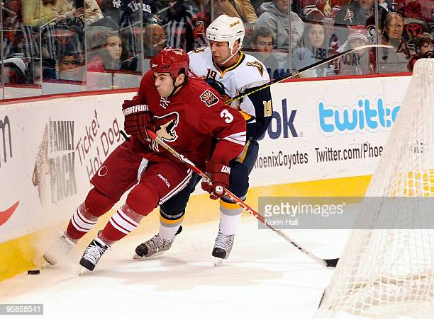 Tim Connolly of the Buffalo Sabres tries to knock Keith Yandle of the Phoenix Coyotes off the puck on January 18 2010 at Jobingcom Arena in Glendale...