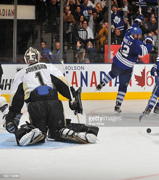 Tim Connolly of the Toronto Maple Leafs celebrates a second period goal as Brent Johnson of the Pittsburgh Penguins looks on during NHL game action...