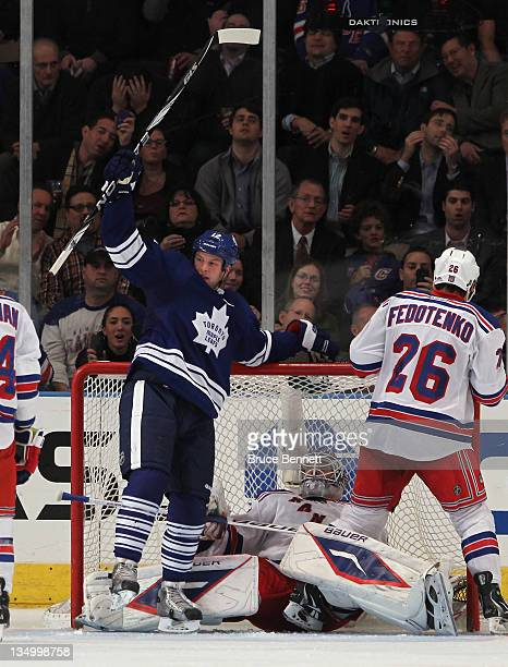 Tim Connolly of the Toronto Maple Leafs scores a second period goal against Henrik Lundqvist of the New York Rangers at Madison Square Garden on...