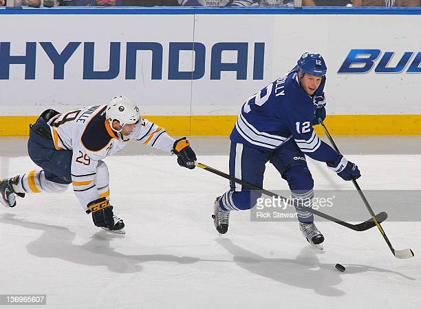 Tim Connolly of the Toronto Maple Leafs skates against Jason Pominville of the Buffalo Sabres at First Niagara Center on January 13 2012 in Buffalo...