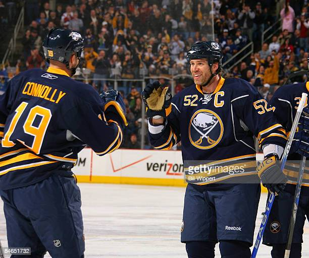 Tim Connolly#19 of the Buffalo Sabres celebrates his first period goal with teammate Craig Rivet of the Buffalo Sabres during the Sabres game against...