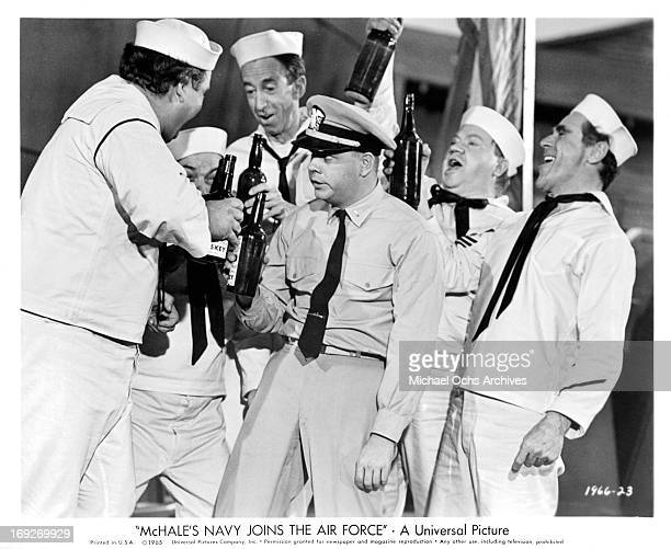 Tim Conway becomes 'pie-eyed' as a result of making numerous toasts with the crew in a scene from the film 'McHale's Navy Joins The Air Force', 1965.