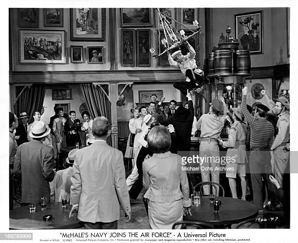 Tim Conway makes a Tarzan like escape to elude the clutches of Russian agents in a scene from the film 'McHale's Navy Joins The Air Force', 1965.