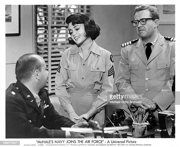 Tim Conway receives affectionate looks from Susan Silo while he gets the 'fish eye' from Joe Flynn in a scene from the film 'McHale's Navy Joins The...