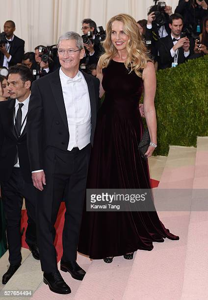Tim Cook and Laurene Powell arrive for the Manus x Machina Fashion In An Age Of Technology Costume Institute Gala at Metropolitan Museum of Art on...