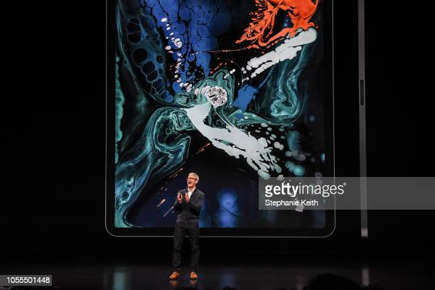 Tim Cook CEO of Apple unveils a new iPad Pro during a launch event at the Brooklyn Academy of Music on October 30 2018 in the Brooklyn borough of New...
