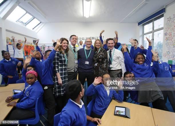 Tim Cook, CEO of Apple, with left to right) teacher Cassey Williams, headteacher Derek Hewie, Executive headteacher Michelle Thomas, Assistant head...
