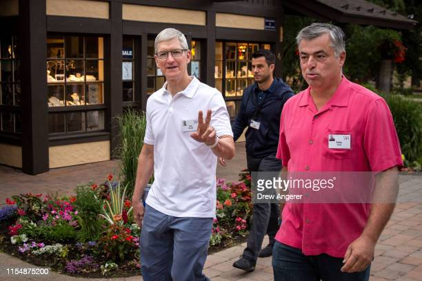 Tim Cook, chief executive officer of Apple, and Eddy Cue, senior vice president of Internet Software and Services at Apple, attend the annual Allen &...