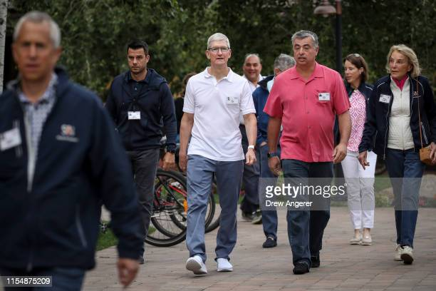 Tim Cook chief executive officer of Apple and Eddy Cue senior vice president of Internet Software and Services at Apple attend the annual Allen...