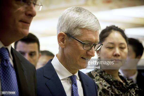 Tim Cook chief executive officer of Apple Inc center arrives at the China Development Forum in Beijing China on Saturday March 24 2018 Leaders...