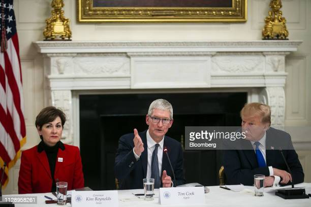 Tim Cook chief executive officer of Apple Inc center speaks while US President Donald Trump right and Kim Reynolds governor of Iowa listen during an...