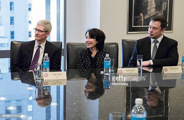 Tim Cook chief executive officer of Apple Inc from left Safra Catz cochief executive officer of Oracle Corp and Elon Musk chief executive officer and...