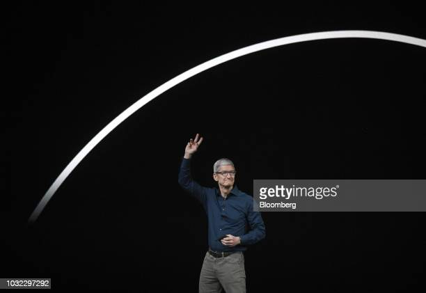 Tim Cook chief executive officer of Apple Inc gestures while exiting the stage during an event at the Steve Jobs Theater in Cupertino California US...