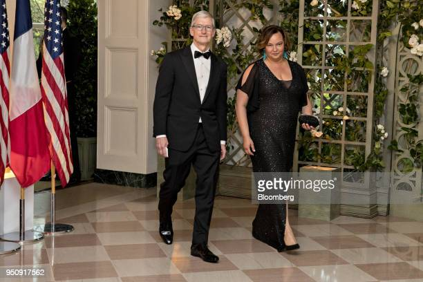 Tim Cook chief executive officer of Apple Inc left and Lisa Jackson vice president of environment at Apple Inc arrive for a state dinner in honor of...