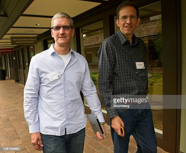 Tim Cook chief executive officer of Apple Inc left and Paul Sagan chief executive officer of Akamai Technologies Inc attend the Allen Co Media and...