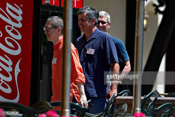 Tim Cook, chief executive officer of Apple Inc., right, and Eddy Cue, senior vice president of internet software and services at Apple Inc., center,...
