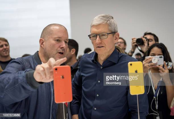 Tim Cook chief executive officer of Apple Inc right and Jony Ive chief design officer for Apple Inc view an iPhone XR smartphone during an event at...