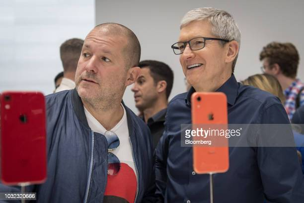 Tim Cook chief executive officer of Apple Inc right speaks with Jony Ive chief design officer for Apple Inc during an event at the Steve Jobs Theater...