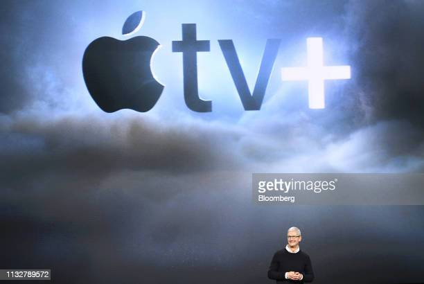 Tim Cook chief executive officer of Apple Inc smiles during an event at the Steve Jobs Theater in Cupertino California US on Monday March 25 2019 The...