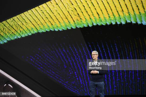 Tim Cook chief executive officer of Apple Inc speaks about the iPhone during an event at the Steve Jobs Theater in Cupertino California US on Tuesday...