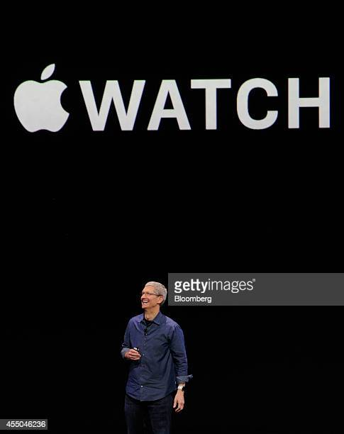 Tim Cook chief executive officer of Apple Inc unveils the Apple Watch during a product announcement at Flint Center in Cupertino California US on...