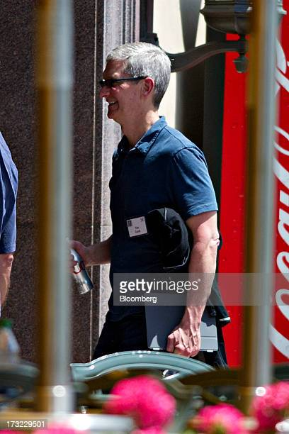 Tim Cook chief executive officer of Apple Inc walks outside during the Allen Co Media and Technology Conference in Sun Valley Idaho US on Wednesday...