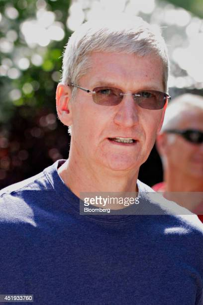 Tim Cook chief executive officer of Apple Inc walks the grounds during the Allen Co Media and Technology Conference in Sun Valley Idaho US on...